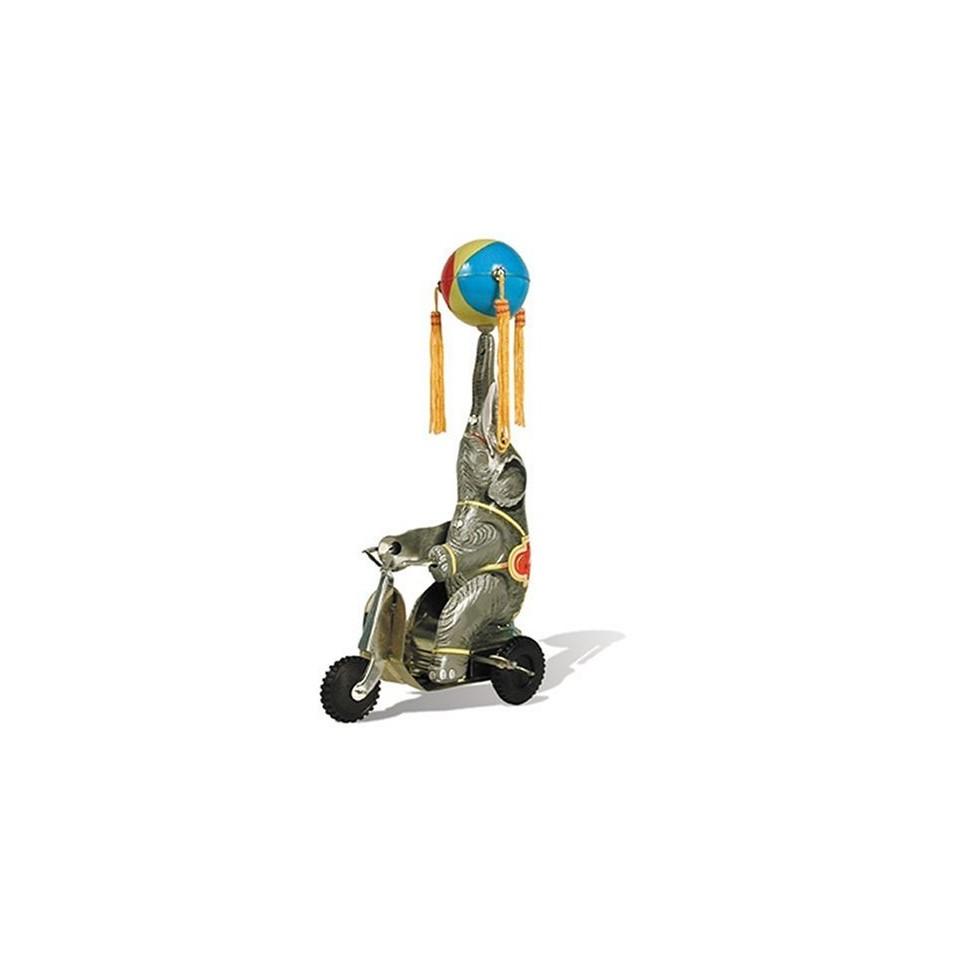 Éléphant sur vélo mécanique